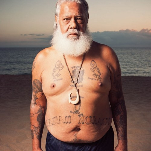 Photo of Delbert Wakinekona on the beach on his home island of Hawai'i.