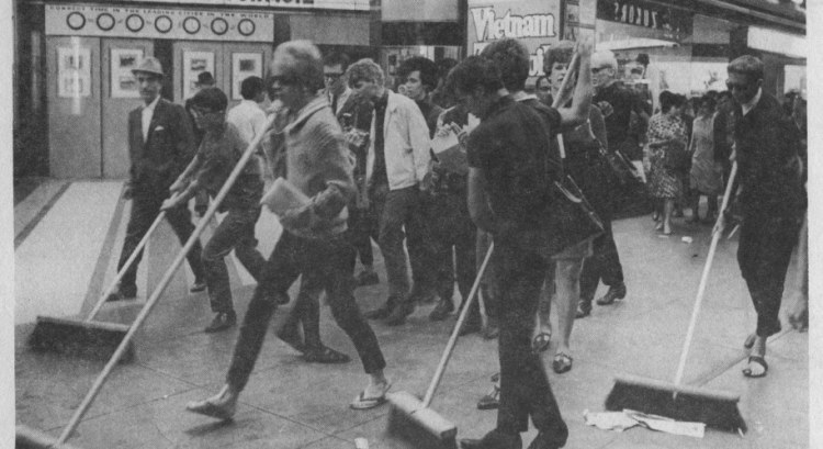 Group of queer homeless youth and allies in San Francisco's Tenderloin district (ca. 1968), called Vanguard, amidst a 'Street Sweep' action in response to attacks by city and corporate interests that worked to rid the city of queer houseless people